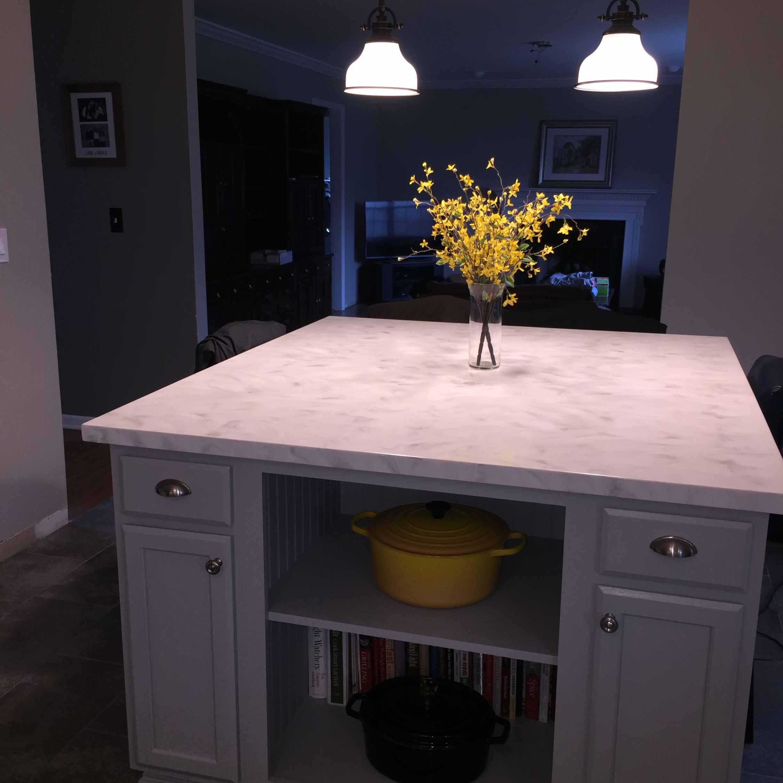 """Wilsonart Moon Geyser solid surface countertop on 54 x 60"""" island"""