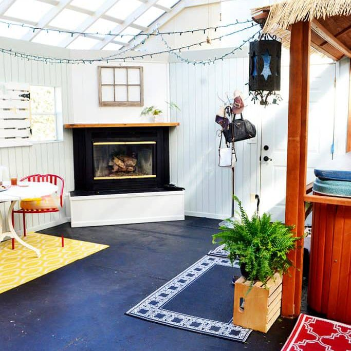 Sunroom with blue floor and fireplace