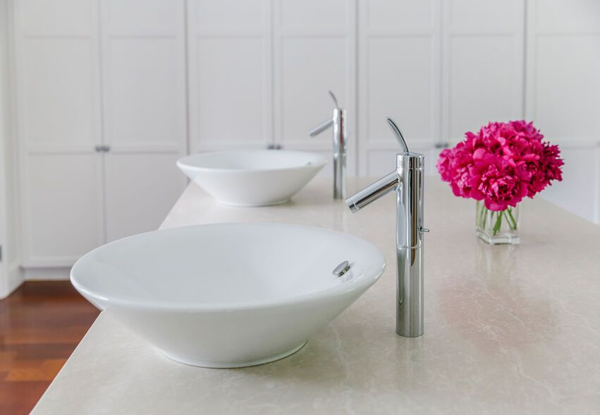 countertop in a bathroom with twin sinks