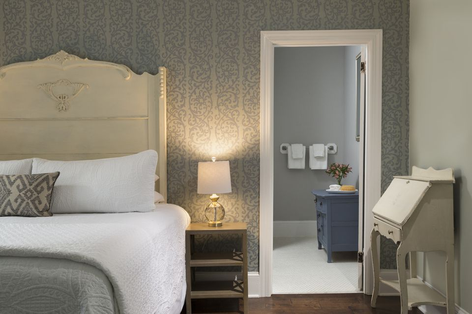 Bedroom and bathroom interior with wallpaper and paint in beige and gray