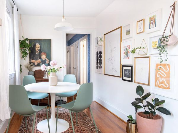 Apartment dining space with large gallery wall.