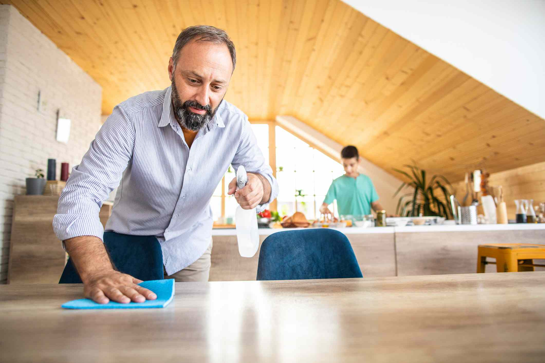 Man cleaning dining table