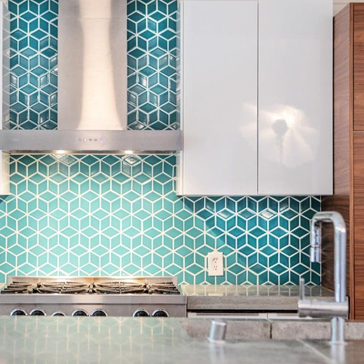 Kitchen with blue, geometric backsplash