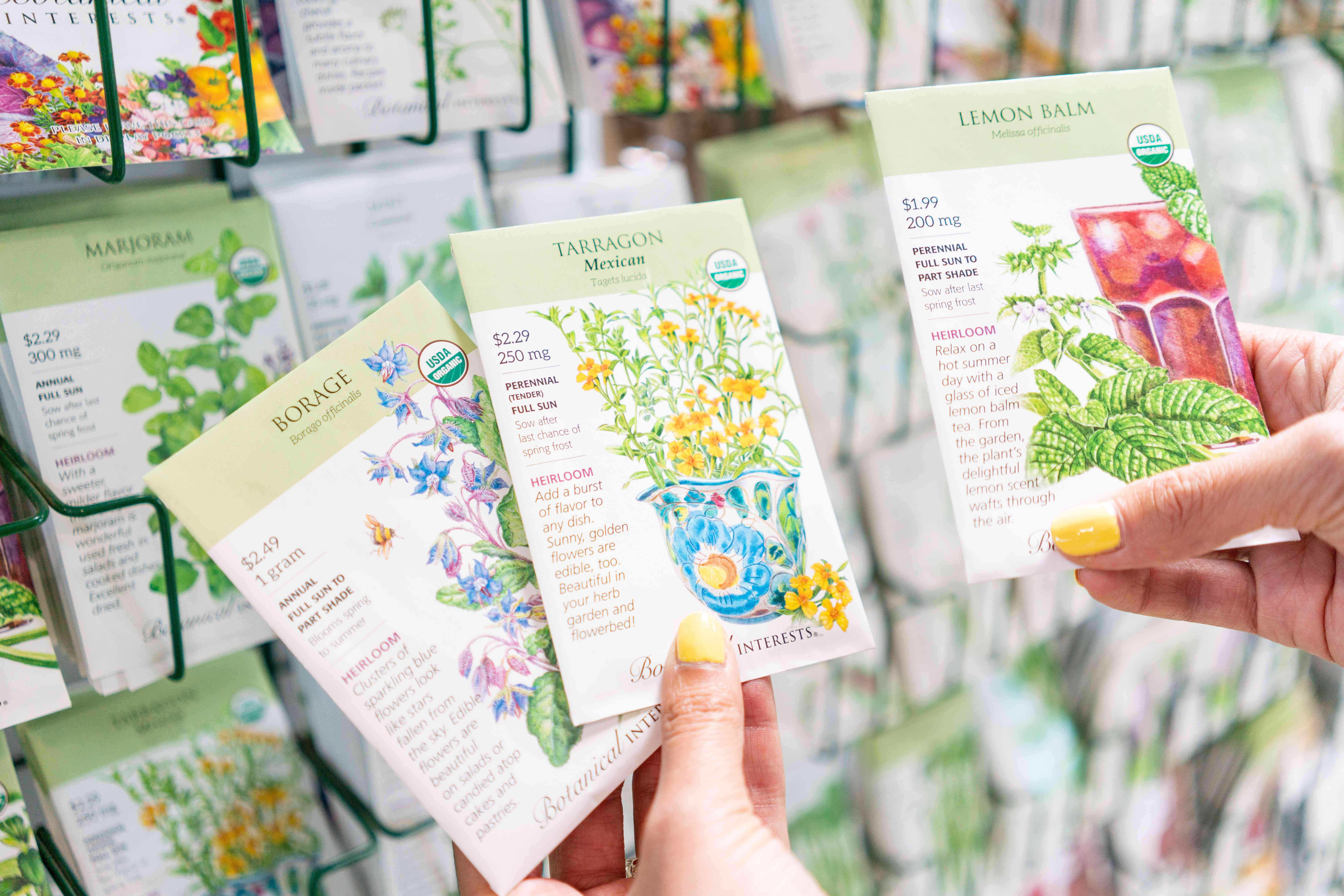 Seed packets selected by hand to be planted