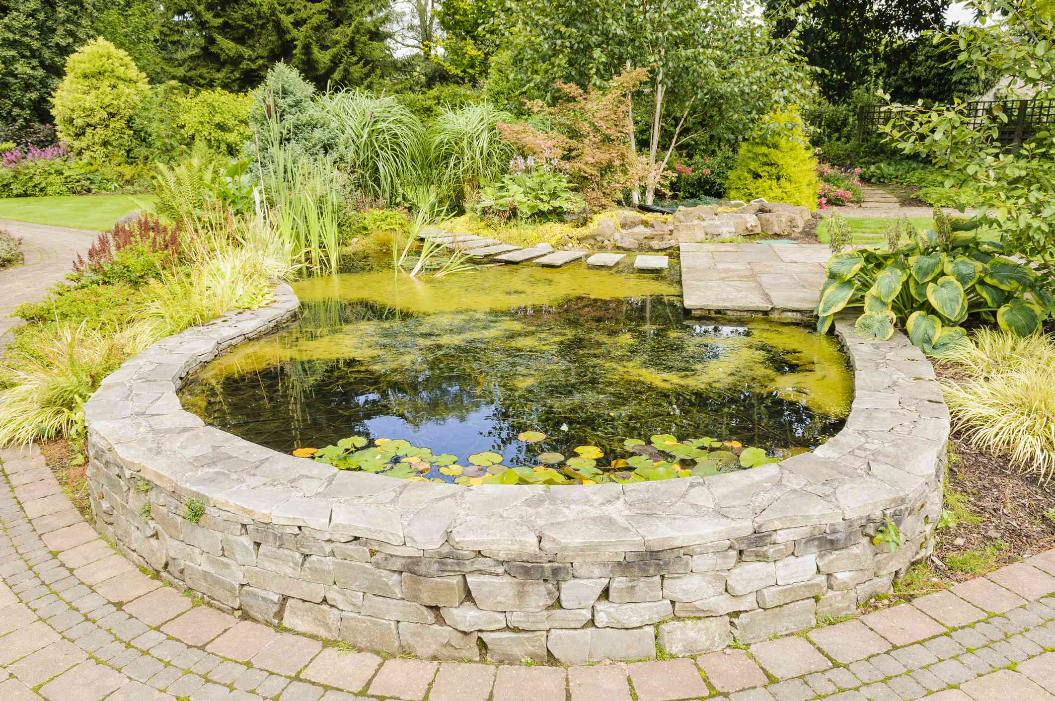 Retaining wall used to enclose a garden pond