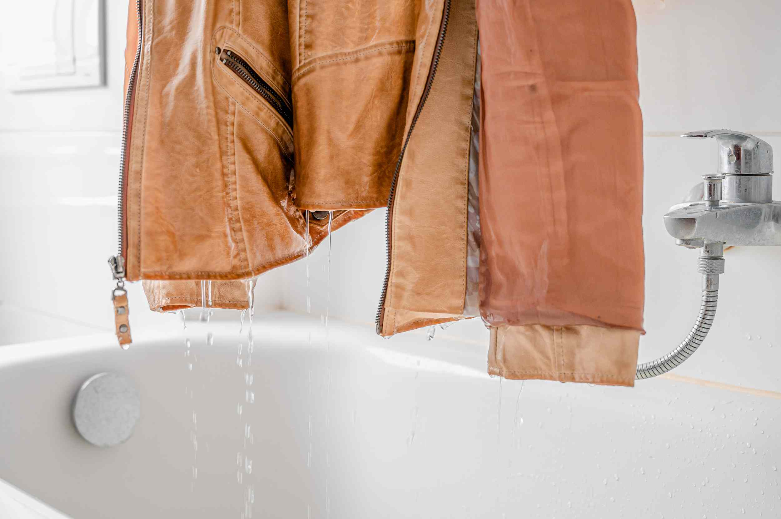 Letting the jacket drip dry over the tub