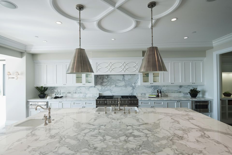 Pendant lights hanging above marble kitchen island