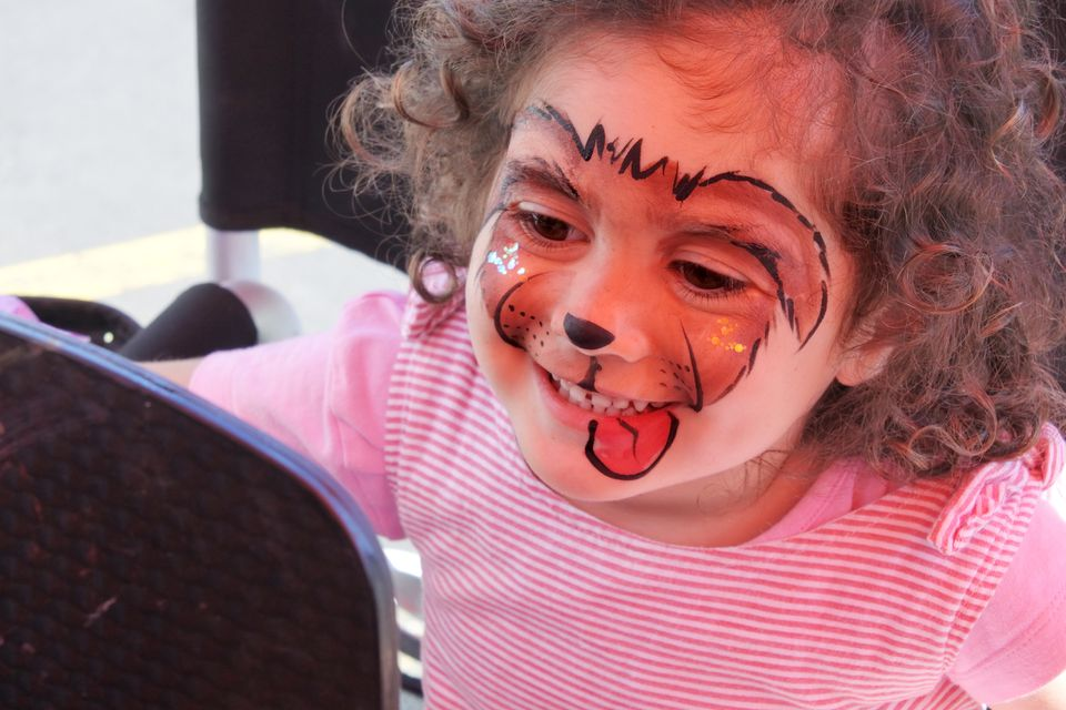Little girl with puppy face painting