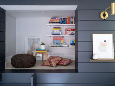 Striking book nook with floor pillows