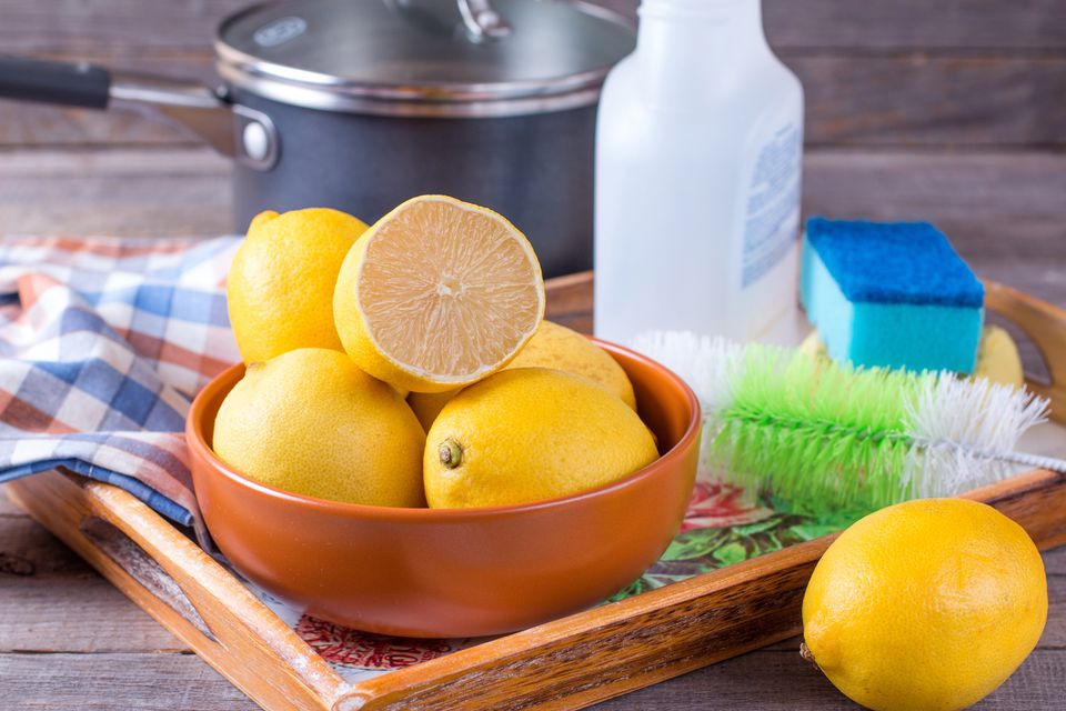 Lemons on a tray with cleaning supplies