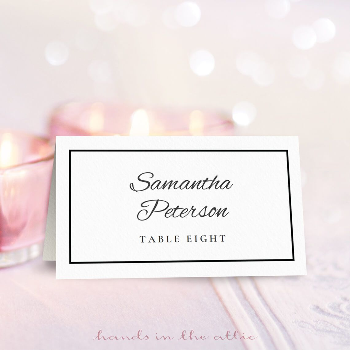 A black and white wedding place card.