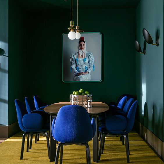 Blue chairs and wall in dining room
