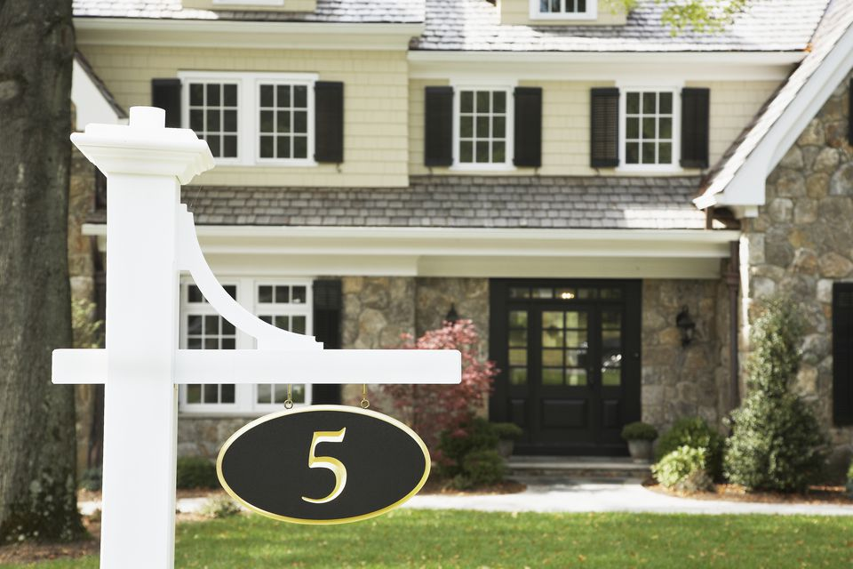 Closeup of a sign displaying a house number