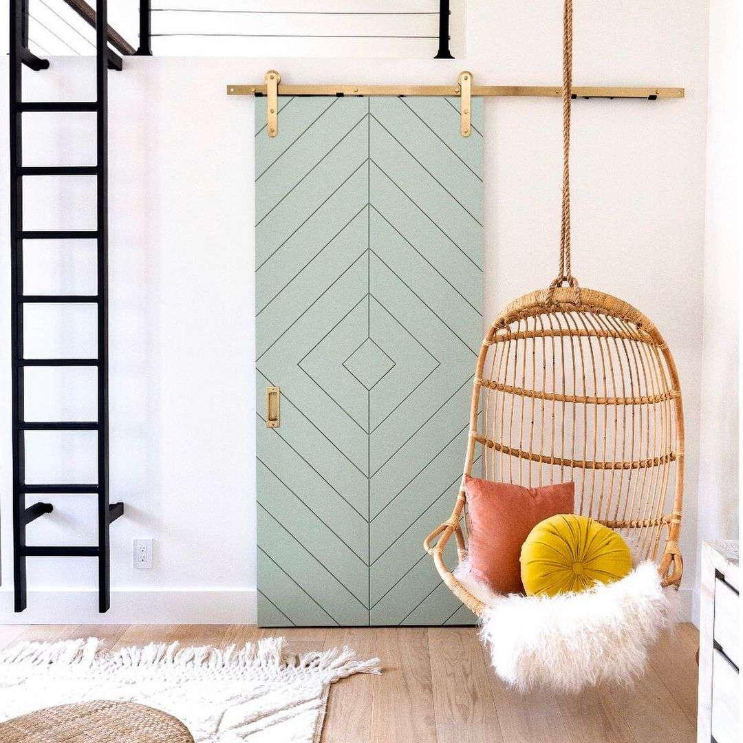 A modern take on a sliding barn door in a loft room.