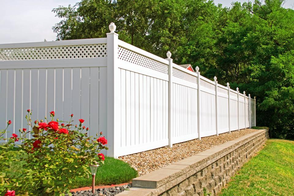 A white PVC vinyl fence