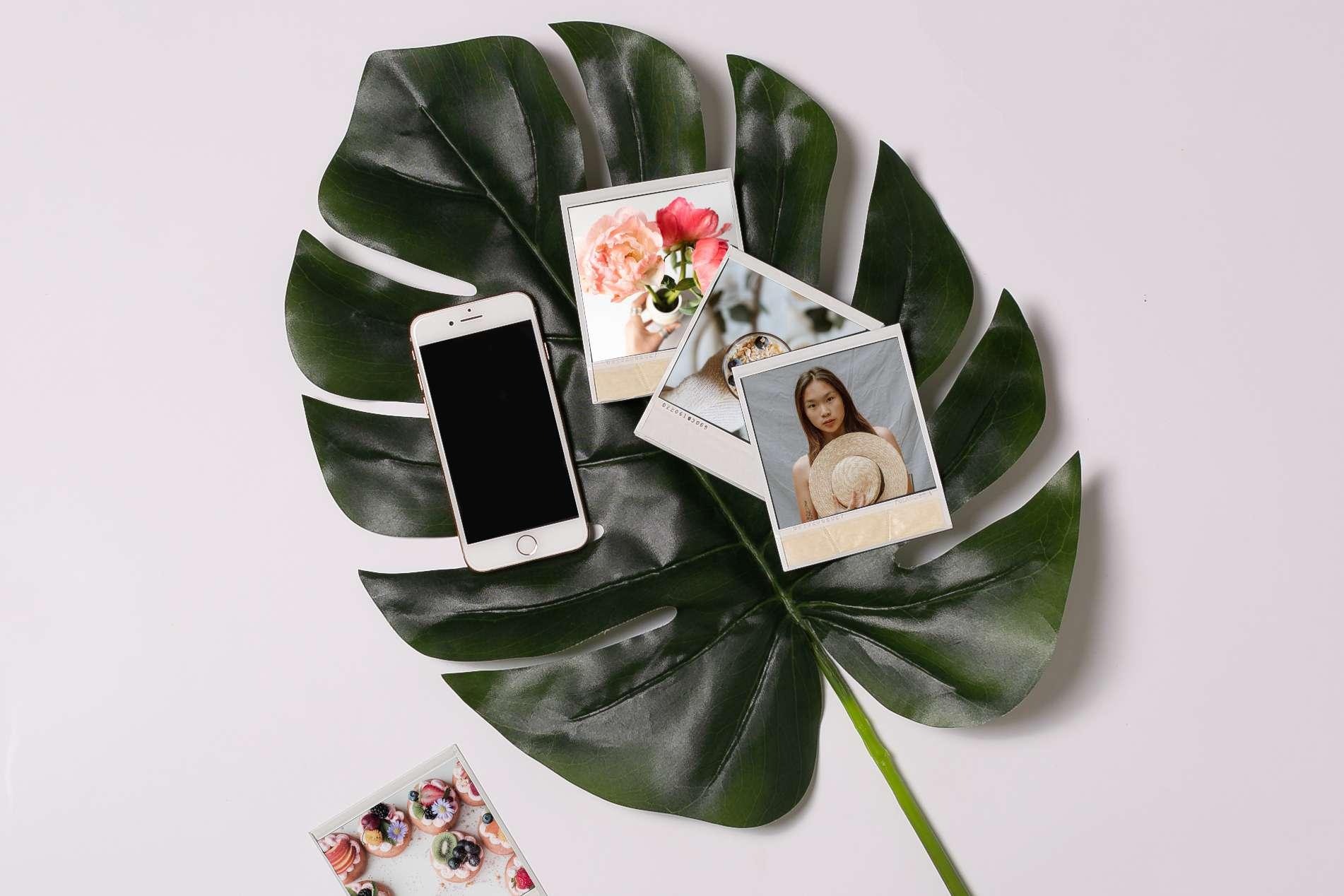 smartphone and polaroid prints