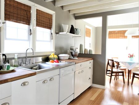 Kitchen With White Cabinets And Open Beam Ceiling