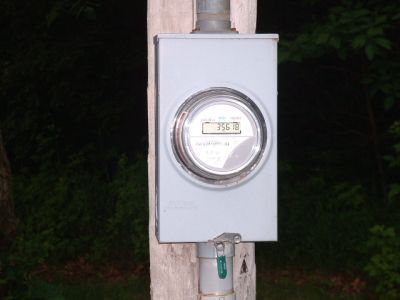 An electric meter mounted on a pole.