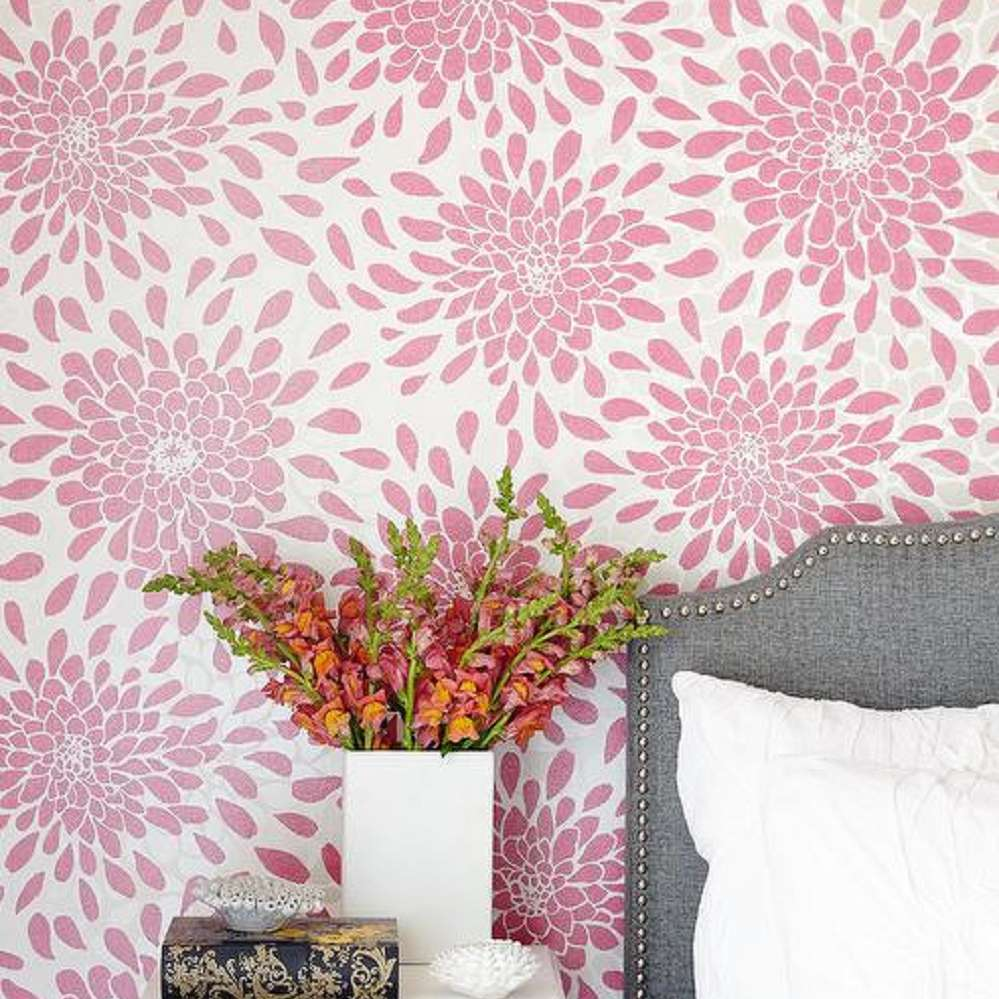 Pink floral wallpaper in traditional bedroom