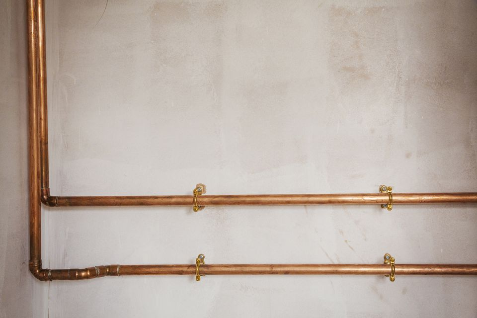 Copper Pipes on a Wall