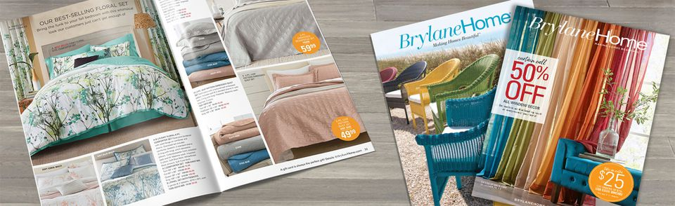 A collection of Brylane Home catalogs laying on a table