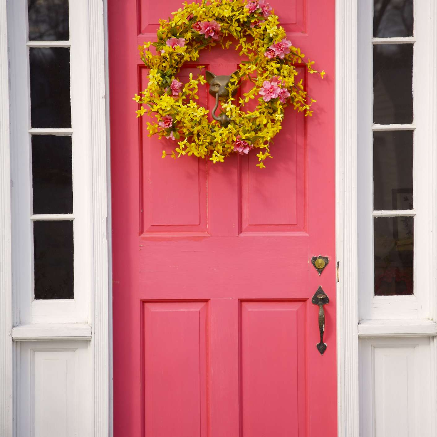 yellow floral spring wreath on a front door