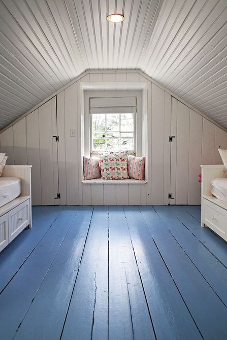 Room in a small attic space with painted blue floor.