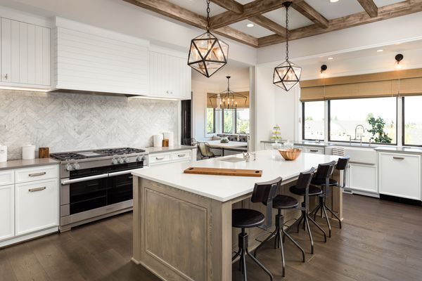 beautiful kitchen in new luxury home with island and pendant light fixtures