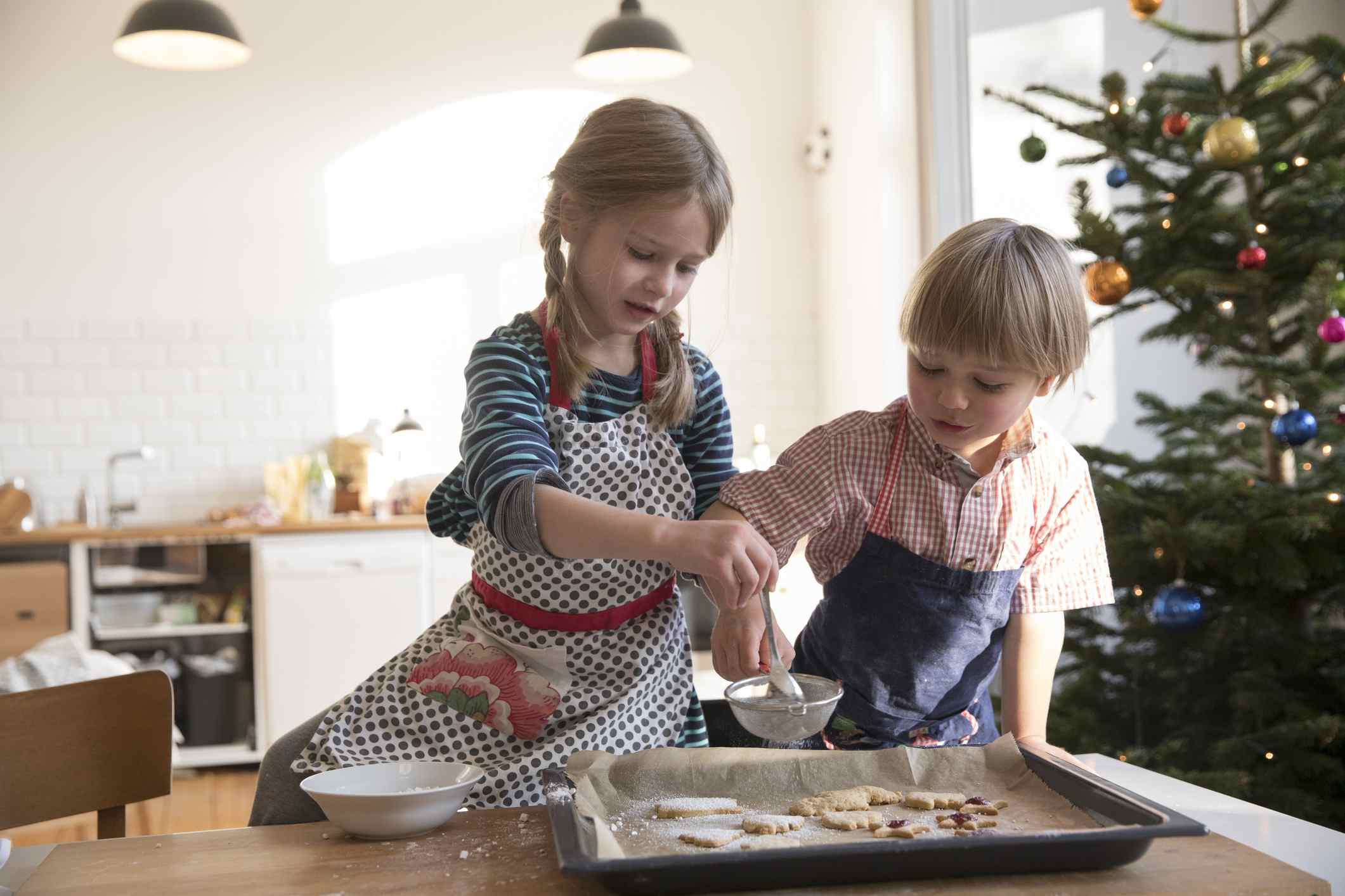 Sister and brother making cookies at christmas