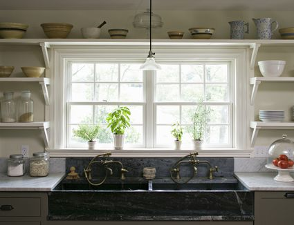 kitchenwindow-GettyImages-158311524-59a70567d963ac0011c2a373 Ranch Home Remodeling Kitchen Ideas on ranch home landscaping, ranch home porch additions, ranch home basement ideas, ranch home exterior paint, ranch home porches, ranch home sunroom addition,