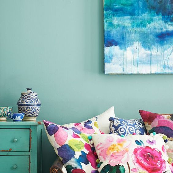 blue room with floral pillows