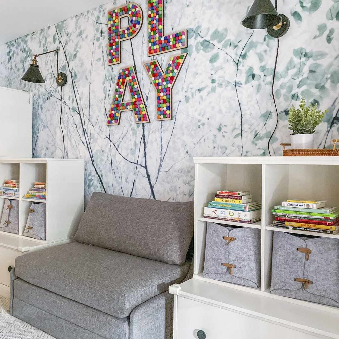 tree branches and leaves speckled throughout bring the outdoors inside in this playroom