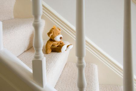 Soft Toy On Carpeted Stairs