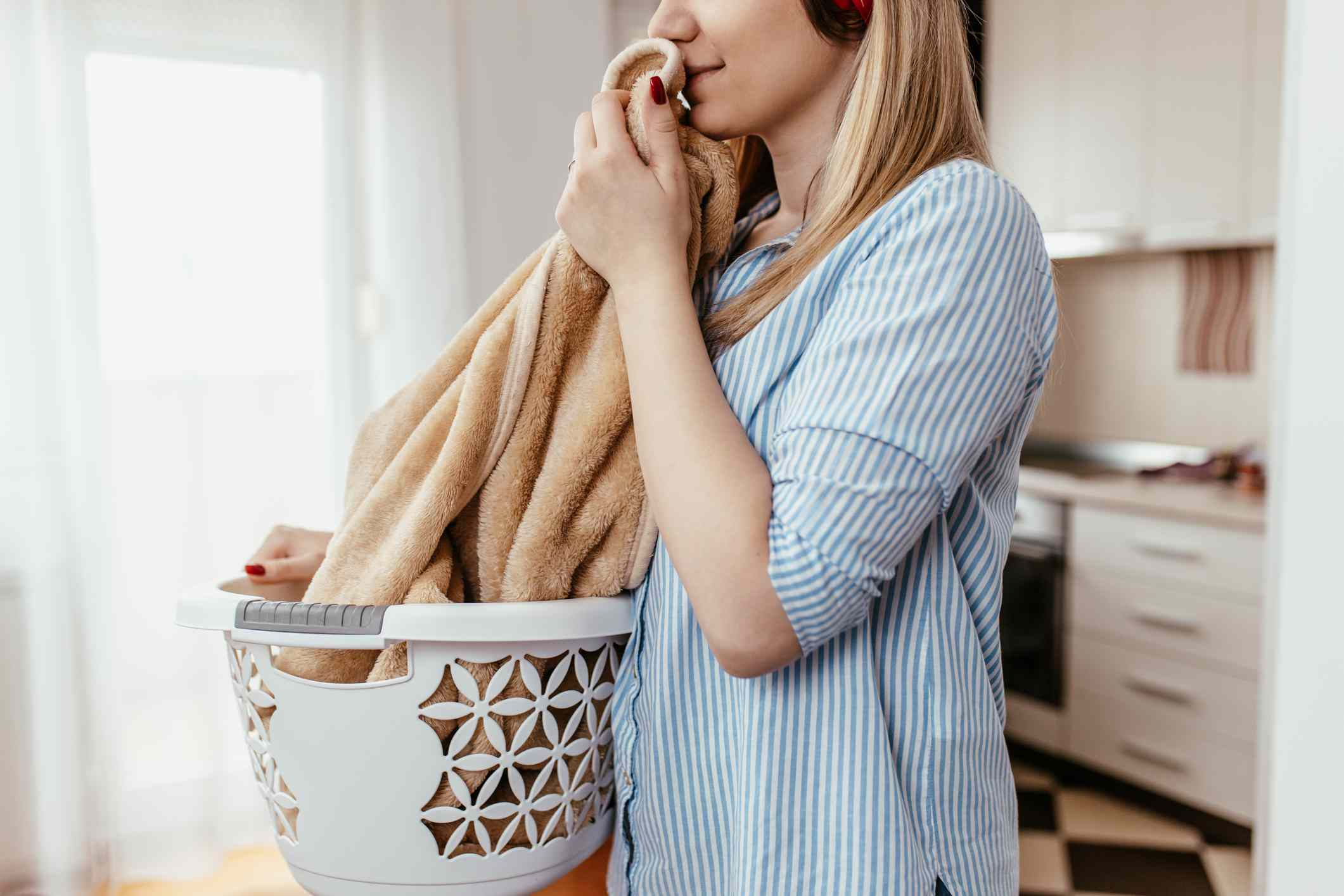 woman smelling clean laundry