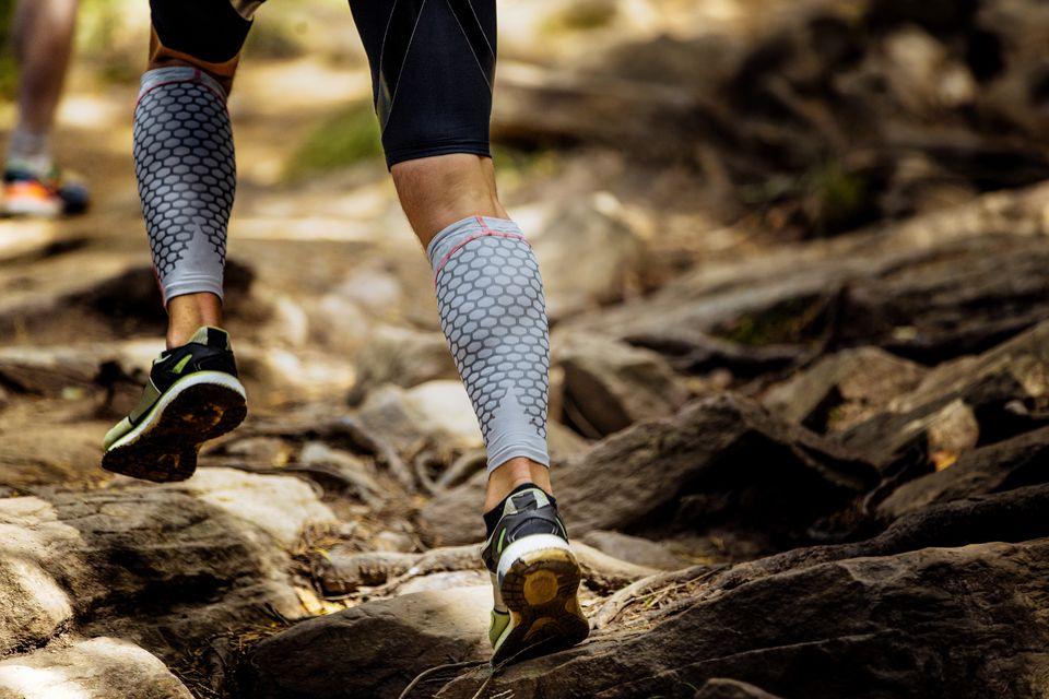 Marathon runner running rocks in mountain