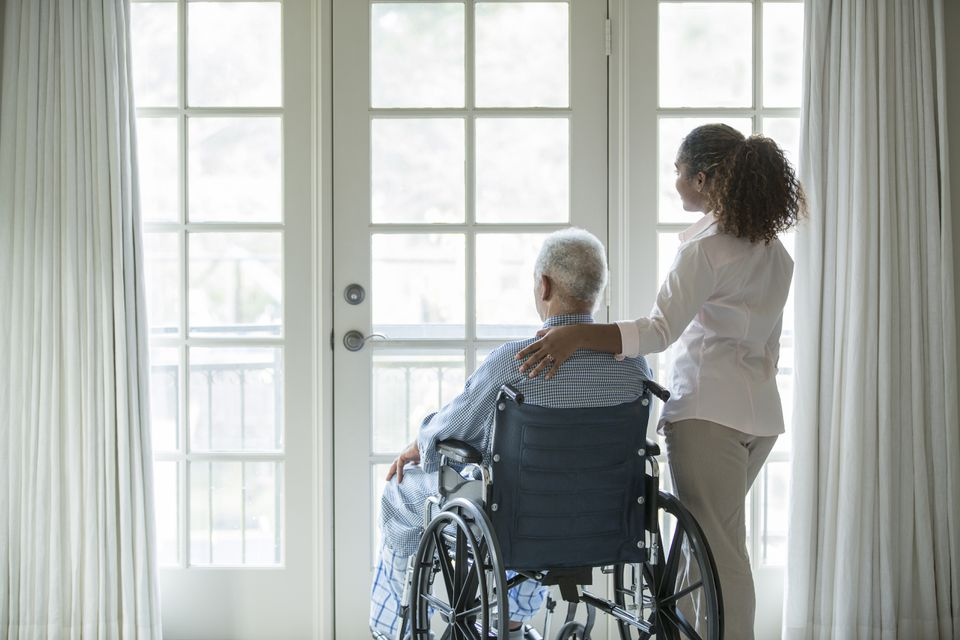 woman with Senior man in wheelchair
