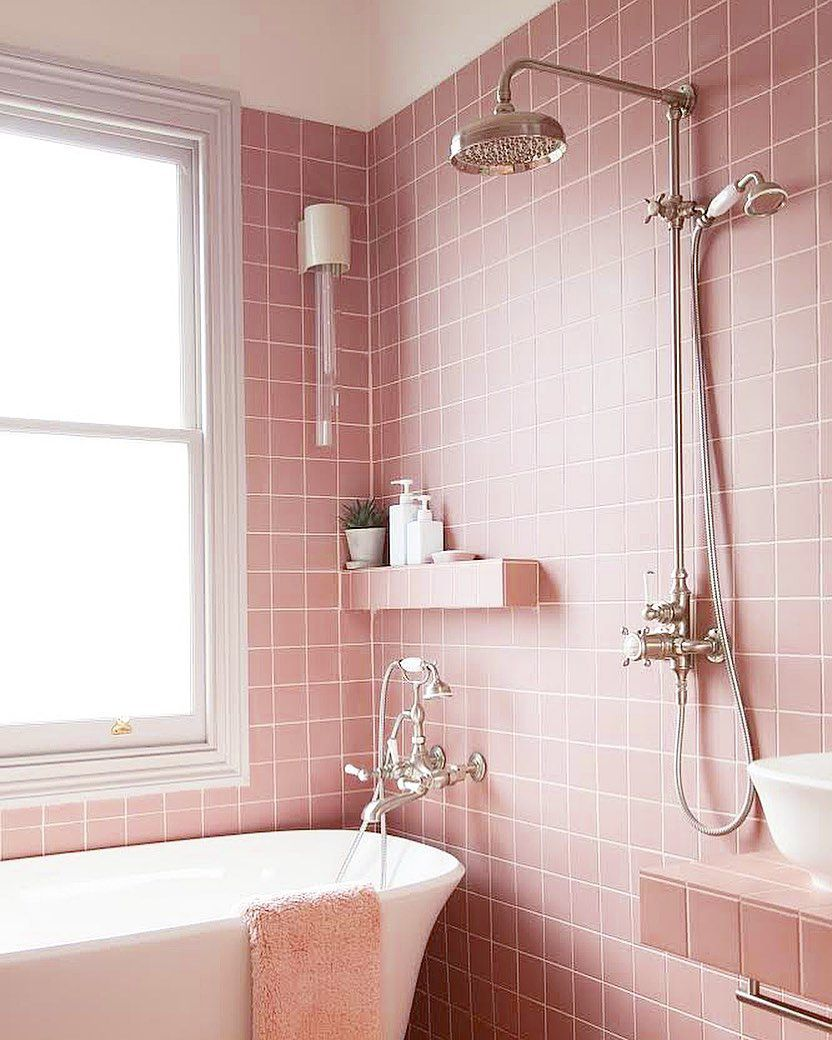 Bathroom with pink tile and tub