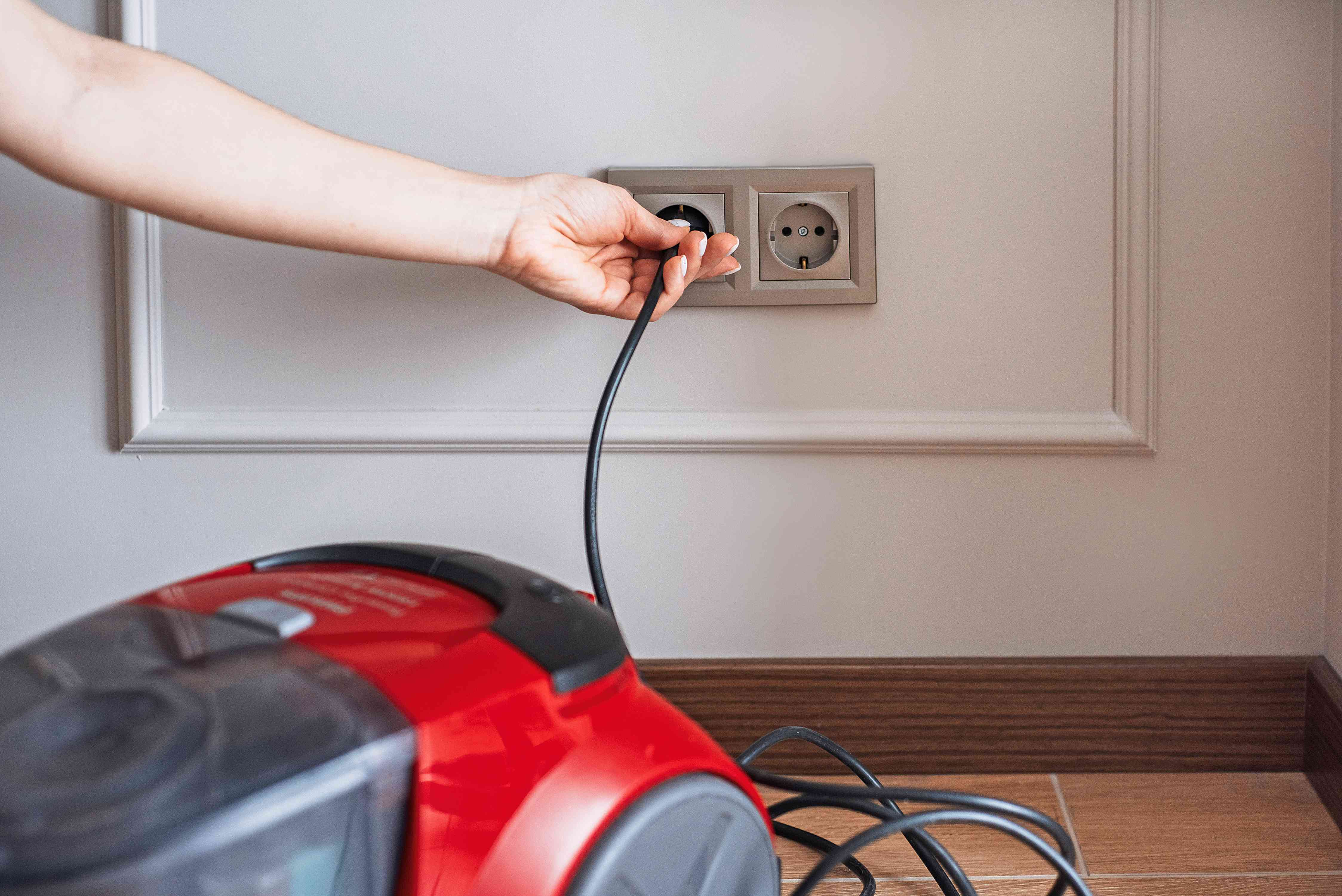 unplugging the vacuum