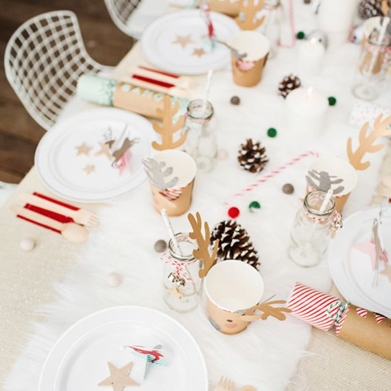 Table decor for Christmas with children's table.