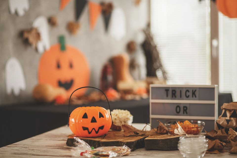 Table with treats and a plastic pumpkin