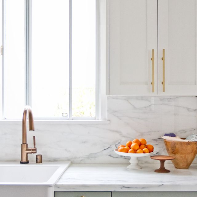 kitchen with pastel cabinets and gold hardware