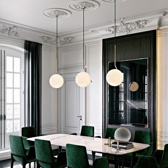 Traditional dining room with green chairs