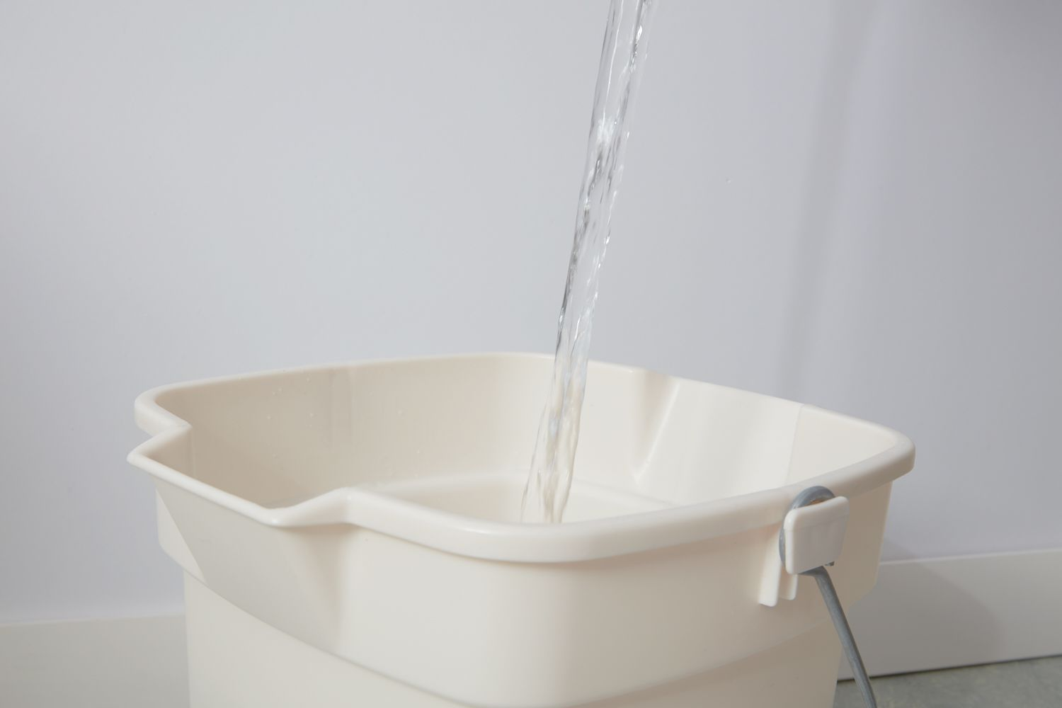 Filling bucket with fresh water to clean floor