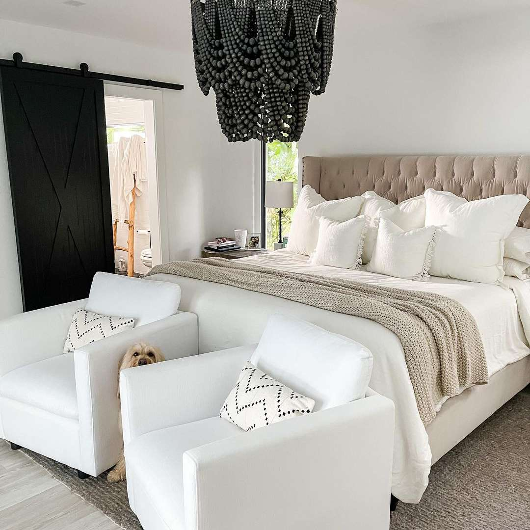 white armchairs in bedroom
