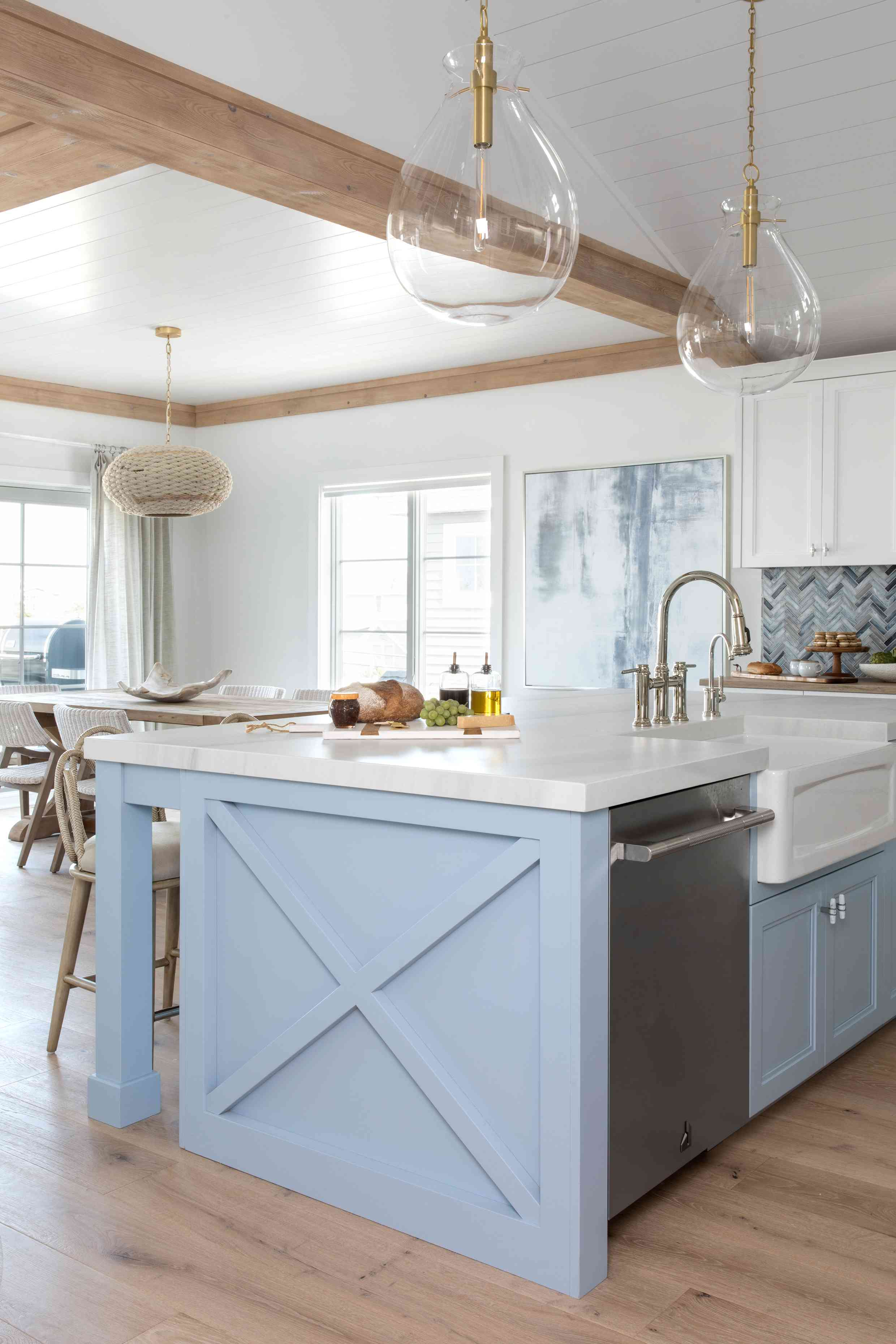 The kitchen in Karen B. Wolfe's Long Beach Island home features a farmhouse sink and sky blue lower cabinets