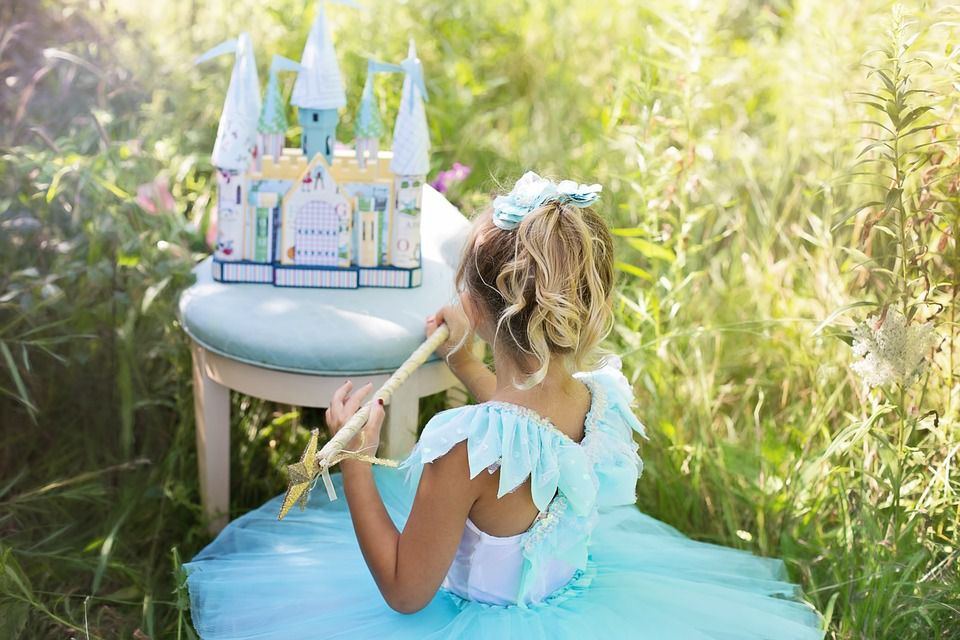 Princess with magic wand and play castle.