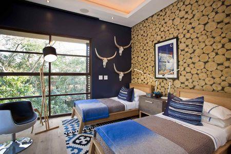 faux log wallpaper dress up a rustic bedroom - Modern Rustic Bedroom