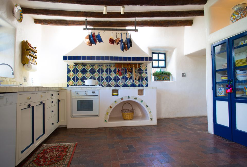 Rustic Southwest USA Kitchen: Brick Floor, Beams, Oven, Counters