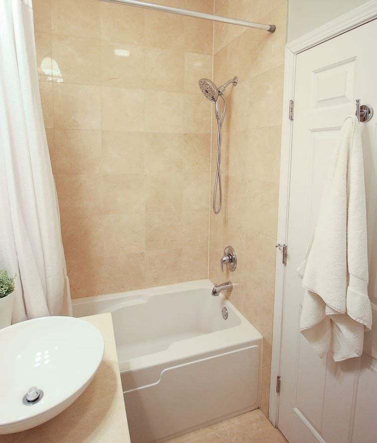 Small bathroom with beige tile.