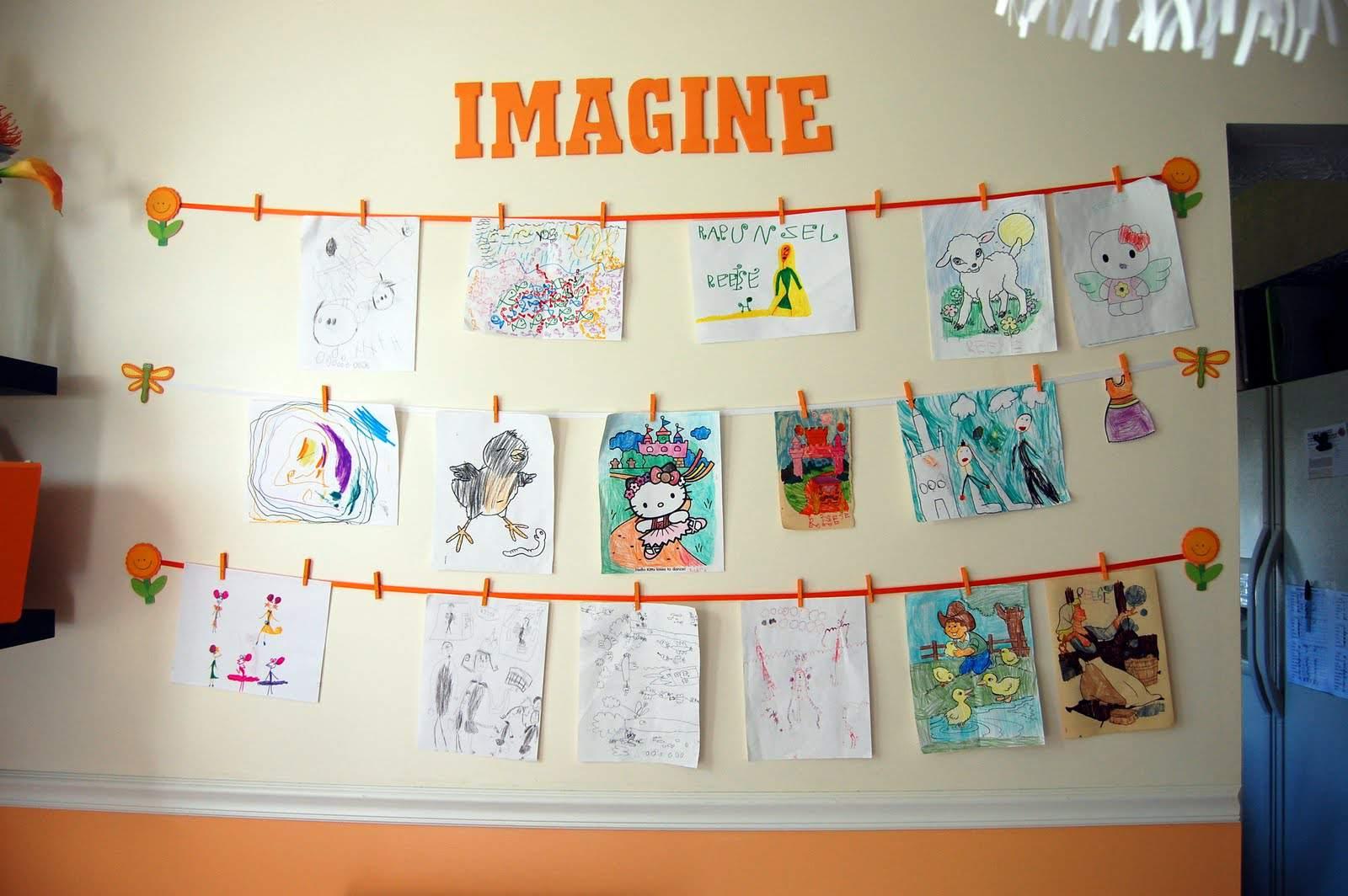 Hang kids artwork on the wall